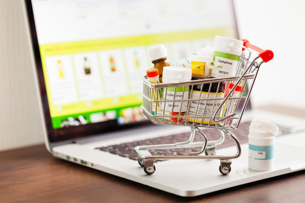 shopping cart filled with prescription medications